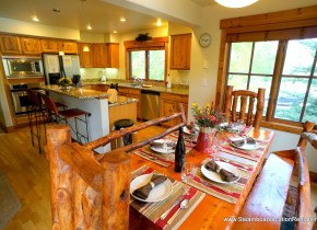 Rental kitchen and dining at Steamboat Vacation Rentals.
