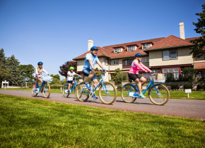 Family biking at Ocean Edge Resort & Golf Club.
