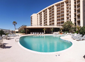 Outdoor pool at The Dunes Condominiums.