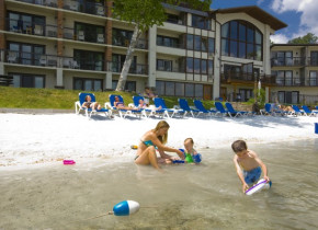 Kids playing at the beach at Golden Arrow Lakeside Resort.