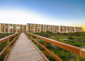 Boardwalk to beach at Beacher's Lodge Oceanfront Suites.