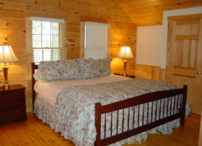 Cabin Bedroom at Point Lookout Resort.