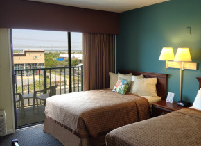 Guest room at Cayman Suites Hotel.