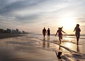 Family on the beach at Ocean Creek Resort.