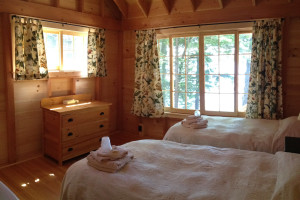 Cabin bedroom at Rockywold-Deephaven Camps.