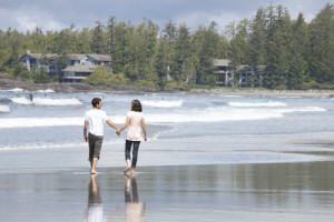 Couple on beach at Wickaninnish Inn.