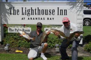 Lighthouse Inn at Aransas Bay sign
