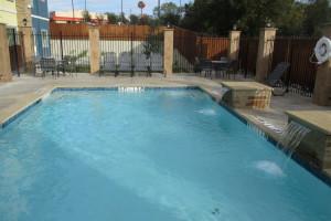 Outdoor pool at BEST WESTERN Plus Lampasas.