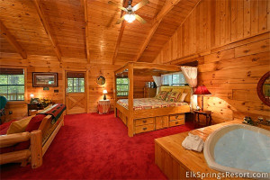 Cabin bedroom with jacuzzi at Elk Springs Resort.