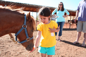 Child and horse at Kah-Nee-Ta Resort and Spa.