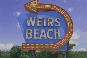 Stroll along the boardwalk on Weirs Beach near Summit Resort.