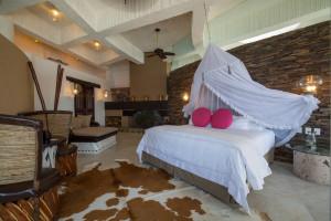 Penthouse bedroom at Ocho Cascadas Resort.
