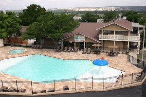 Outdoor pool at Hill Country RV Resort & Cottage Rentals.