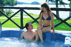Couple in hot tub at Severn Lodge.