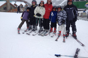 Family skiing at Banff Lodging Company.