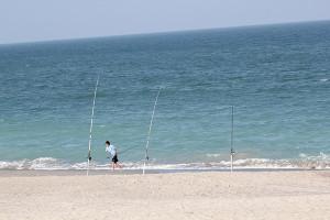 Fishing on beach at Tuckaway Shores Resort.