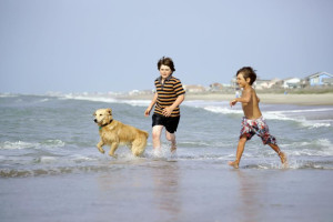 Kids on beach at Williamson Realty. Inc.