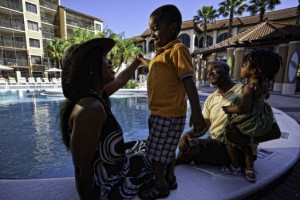 Family by pool at Westgate Lakes Resort & Spa.