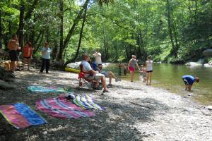 Swimming in the river at Yogi Bear's Jellystone Resort Cherokee.