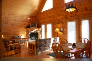 Cabin living room and dining table at Warrens Lodging.