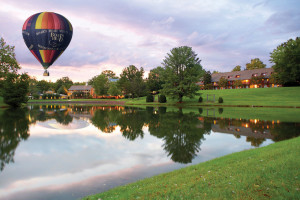Hot air balloon over lake at The Boar's Head.