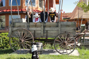 Playing in the covered wagon at K3 Guest Ranch.
