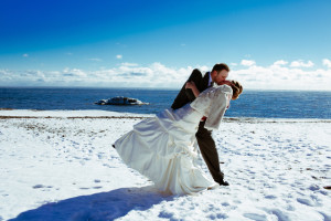 Wedding couple in snow at Lutsen Resort on Lake Superior.