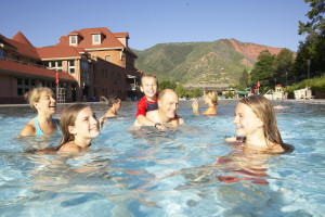 Family swimming in springs at Glenwood Hot Springs.