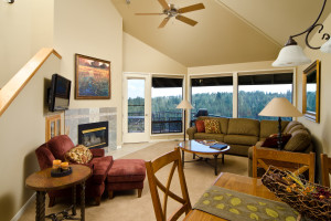 Living and dining room of a River Ridge Condo at Mount Bachelor Village Resort.