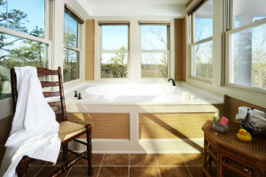 Manor House Sunroom Suite hot tub at the Lookout Cottages Estate