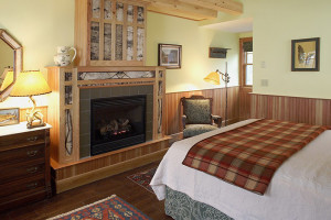 Fireplace guest bedroom at Hotel Mountain Brook.