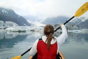 Kayaking through glacier at Kenai Fjords Glacier Lodge.