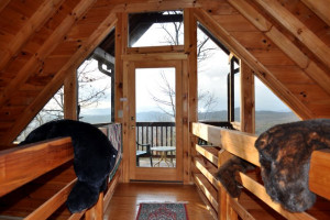 Cabin bedroom at Cuddle Up Cabin Rentals.