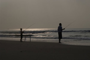 Fishing on the beach at Ocean Isle Inn.
