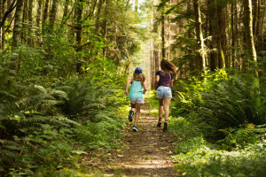 Kids running in the woods at The Resort At Port Ludlow.