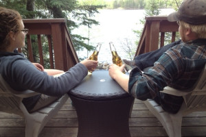 Couple on deck at Timber Wolf Lodge Cabins.