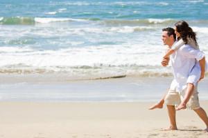 Couple on beach at Hilton Garden Inn Outer Banks.