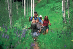Family hiking near Vail's Mountain Haus.