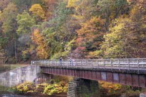 Bike riding over the bridge at New River Trail Cabins.