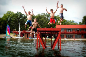 Kids jumping in lake at Fair Hills Resort.