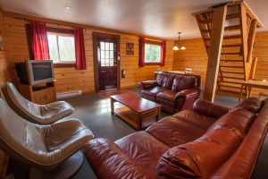 Cabin living room at Glacier House Resort.