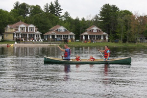 Family canoeing at Bayview Wildwood Resort.