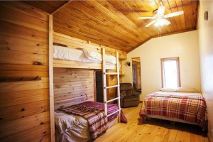 Cabin bedroom at Red River Gorge Cabin Company.