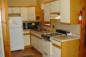 Cabin kitchen at Lykins Pinehurst Resort.