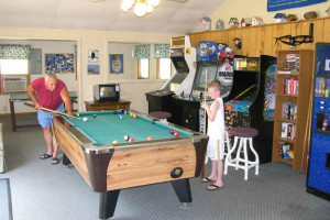 Playing billiards at Robin's Resort.