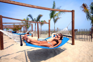 Relax on a hammock on the beach at Holiday Inn Oceanfront Ocean City.