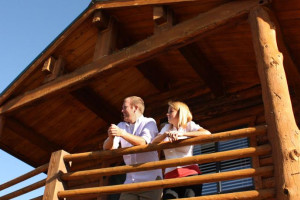 Couple on cabin suite deck at Zion Ponderosa Ranch.