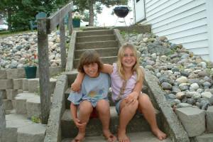 Kids sitting on steps at Sunset Bay Resort.