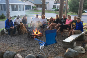 Family by campfire at Nitschke's Northern Resort.