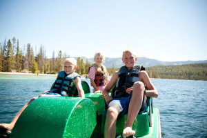 Family paddle boating at Redfish Lake Lodge.